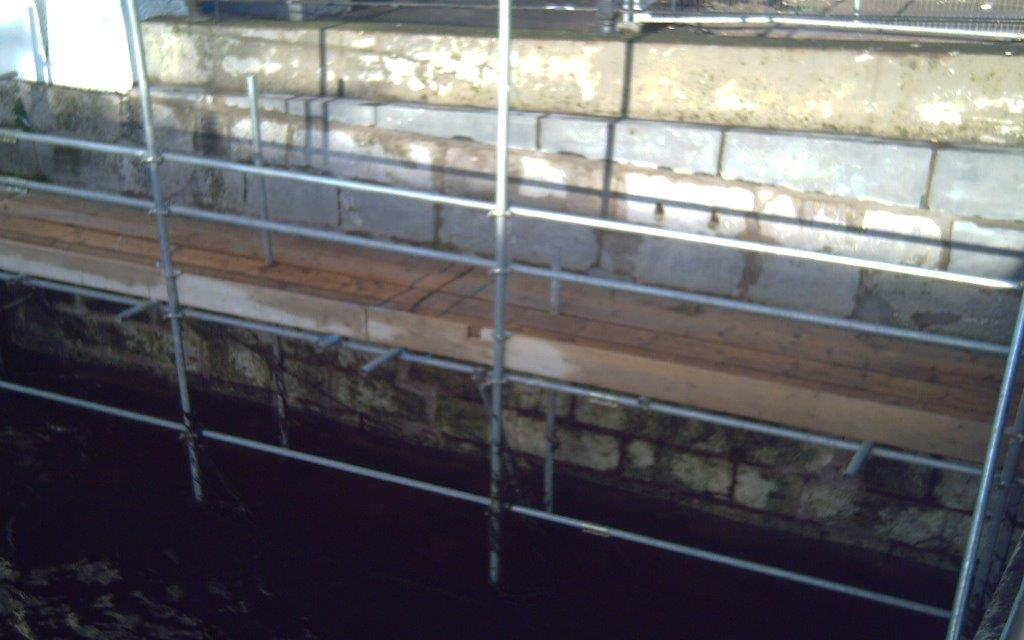 scaffolding by river